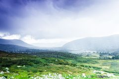 Colorful gentle hills. In the cloudy sky stock images