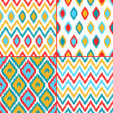 Colorful geometric ikat asian traditional fabric seamless patterns set of four, vector. Background Stock Illustration