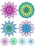 Colorful geometric patterns. Four different colorful geometric or kaleidoscopic style patterns. Each pattern is both filled in with color and as an outline. As a Royalty Free Stock Photography