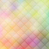 Colorful geometric texture with rhombus on blurred gradient back Royalty Free Stock Photos