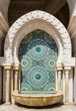 Detail of a mosque in Casablanca. Colorful and geometrical mosaic arabic wall made of tile inside a fountain with pillars and arch located in The Hassan II Stock Images