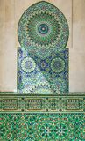 Detail of a mosque in Casablanca. Colorful and geometrical mosaic arabic wall made of tile inside a fountain with pillars and arch located in The Hassan II Royalty Free Stock Photo