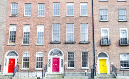 Colorful Georgian doors in Dublin (red,pink,yellow) Stock Image