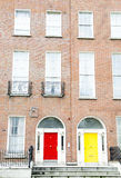 Colorful Georgian doors in Dublin (red,yellow). Special in Europe Royalty Free Stock Image