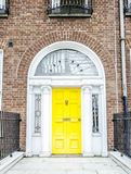 Colorful Georgian doors in Dublin (yellow) Royalty Free Stock Photo