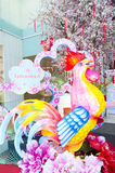 Colorful giant rooster and red Chinese lanterns Stock Photos