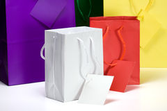 Colorful Gift Bags. Five colorful gift bags.  With rope handles and gift tags.  All empty and on a white background Royalty Free Stock Photos