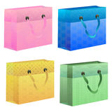 Colorful gift bags for any occasion. Set of pink, blue, green and yellow gift bag with cheerful patterns Stock Photo