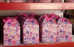 Colorful gift bags with gifts on the store shelf royalty free stock photography