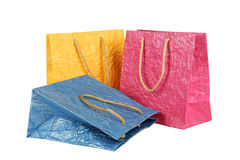 Colorful gift bags isolated on white. Stock Photos