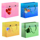 Colorful gift bags with thematics tags. Thematic colorful gift bags Royalty Free Stock Images