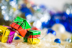 Colorful gift and blue green red gold ball decoration on chrismas.  Royalty Free Stock Photos