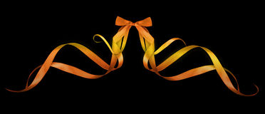 Colorful gift bows with ribbons. On a black background Royalty Free Stock Photography