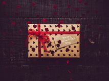 Colorful gift box on a dark surface background stock image