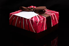 Colorful gift box with empty tag Stock Image