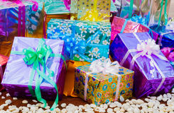 Colorful gift box on the gound with white pebbles Stock Image