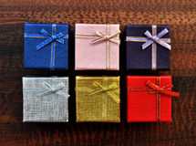 Colorful gift box top texture. On table background stock image