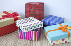 Colorful gift boxes. On a bamboo surface Stock Images