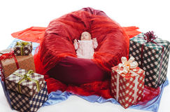 Colorful gift boxes with beautiful baby Stock Photo