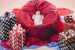 Colorful gift boxes with beautiful baby Royalty Free Stock Images