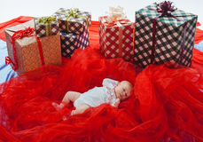 Colorful gift boxes with beautiful baby Royalty Free Stock Image