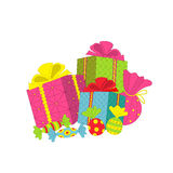 Colorful gift boxes with bow and candy Royalty Free Stock Image