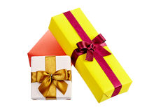 Colorful gift boxes with bows and ribbons isolated in white Stock Image
