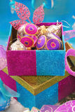 Colorful gift boxes with christmas baubles Royalty Free Stock Images