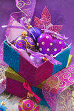 Colorful gift boxes with christmas baubles Stock Photo