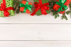 Colorful present boxes for any holiday on wooden background Royalty Free Stock Photos