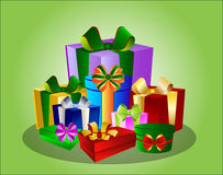 Colorful gift boxes on green Stock Photos