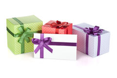 Colorful gift boxes and letter with ribbon and bow Royalty Free Stock Image