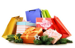 Colorful gift boxes and paper bags on white Stock Photo