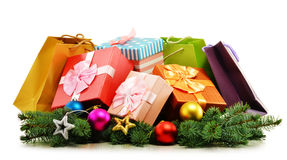 Colorful gift boxes and paper bags on white. Background Royalty Free Stock Photos