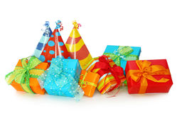 Colorful gift boxes and party hats Royalty Free Stock Photos