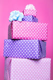 Colorful gift boxes with ribbon over pink background. Pink, purple, pastel, bright Royalty Free Stock Photo