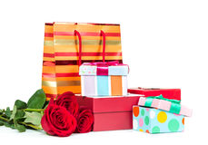 Colorful gift boxes and roses Royalty Free Stock Images