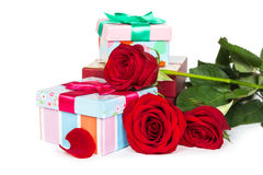 Colorful gift boxes and roses Stock Image