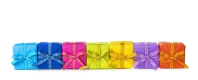 Colorful gift boxes. In a row on a white background Royalty Free Stock Photo
