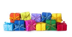 Colorful gift boxes. In a row on a white background Royalty Free Stock Photos
