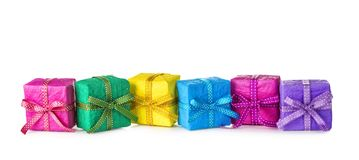Colorful gift boxes. In a row on a white background Stock Photos