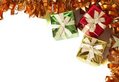 Colorful gift boxes and tinsel forming a frame Royalty Free Stock Photo