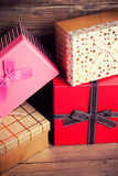 Colorful gift boxes. On wooden background Stock Photography