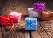 Colorful gift boxes on wooden background Stock Photo
