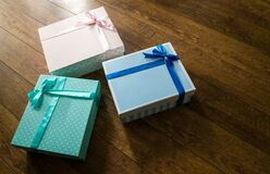 Colorful gift boxes on wooden floor Stock Photos