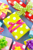 Colorful gift boxes wrapped in dotted paper Stock Photo