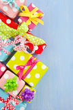 Colorful gift boxes wrapped in dotted paper Royalty Free Stock Images