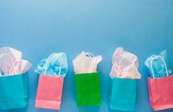 Colorful gift paper bags on blue background with copy space/summer shopping concept.  stock photo