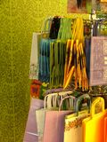 Colorful giftbags. A variety of colorful paper gift bags on a rack Stock Photography