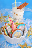 Colorful gingerbread cookies and glass of milk for santa Royalty Free Stock Image